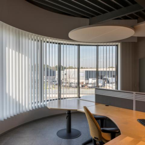 Curved vertical vinyl slats