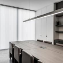 Vertical synthic blinds in an office